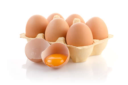 broken egg: Eggs in carton on white with clipping path
