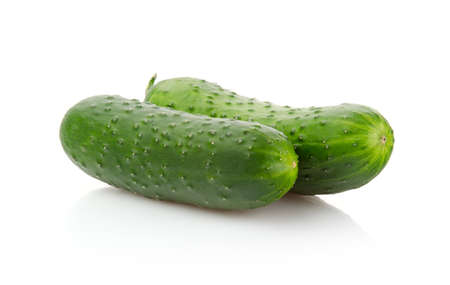 Two fresh Cucumbers isolated on white background