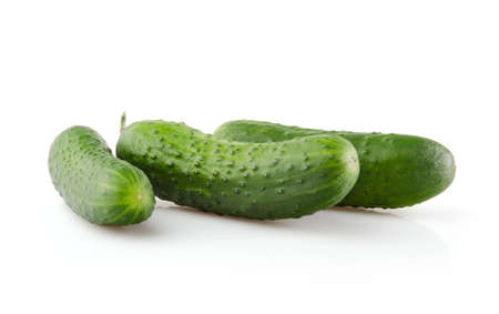 Three fresh Cucumbers isolated on white background