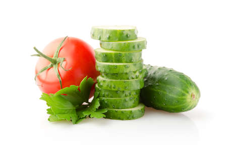Fresh Tomatoes, Cucumbers and Parsley isolated on white background