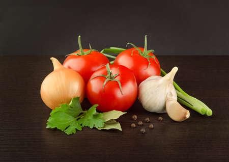 Fresh Tomatoes, Onion, Garlic and Parsley Stock Photo