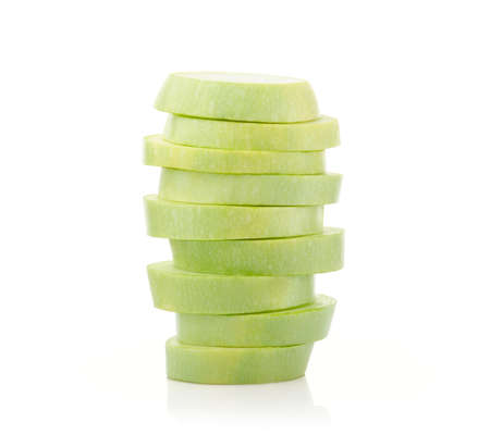 marrow squash: Stack of marrow squash slices isolated on white background Stock Photo