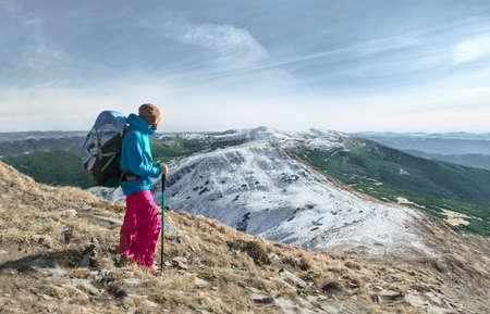 Hiker on mountain trail, European Alps Stock Photo