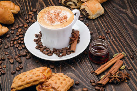 sweet pastries: Cup of Coffee with Pastry on brown wood table background