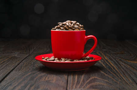 morning coffee: Coffee Beans in a Cup on old wood background Stock Photo