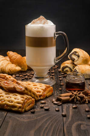 Cup of Coffee with Pastry on brown wood table Archivio Fotografico