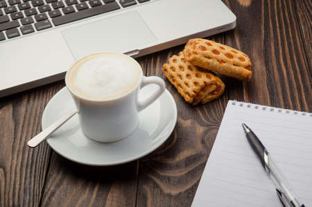note pad: Cup Coffee, Computer and Note Pad on old wood background