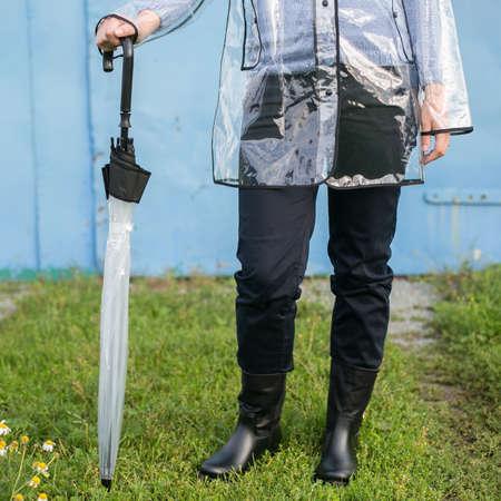 rains: Woman with umbrella in the rain