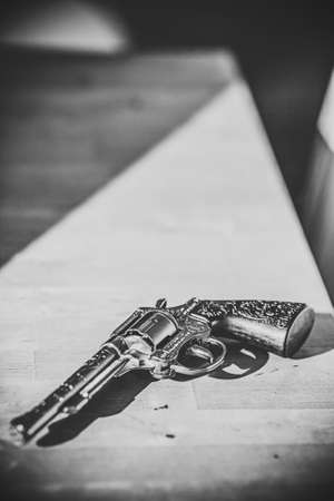 sniper training: vintage gun lying on a wooden table