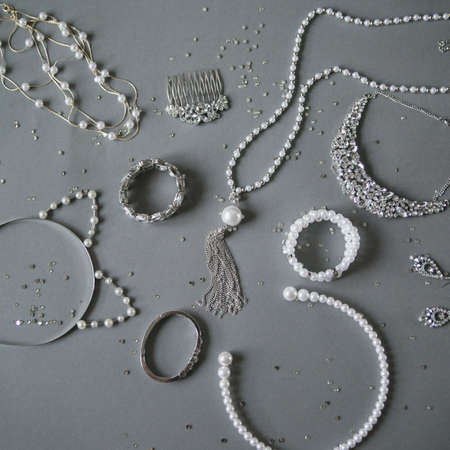 luxury goods: womens jewelry on a gray background