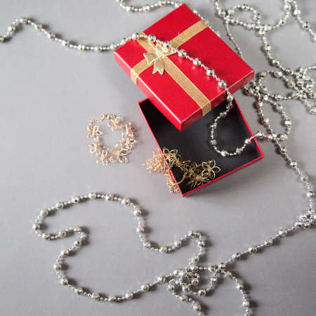 pretty s shiny: accessories and jewellery next to the red box on the background Stock Photo