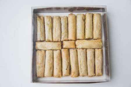 filo: Baklava is a Middle-Eastern dessert. It is a rich, sweet pastry made of layers of filo filled with chopped nuts