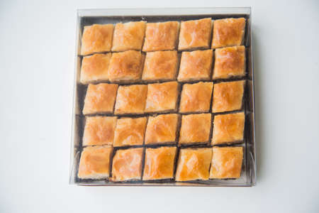 baklawa: Baklava is a Middle-Eastern dessert. It is a rich, sweet pastry made of layers of filo filled with chopped nuts