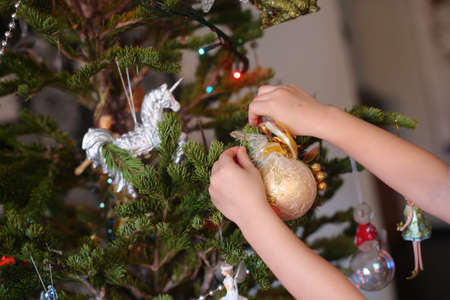 decorating christmas tree: holiday traditions decorating the Christmas tree