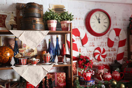 hearthside: Christmas home decoration with tree, gifts and fireplace.