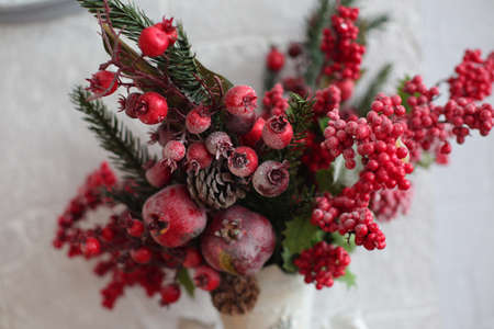 pinecones: Variegated holly decoration with red berry cluster