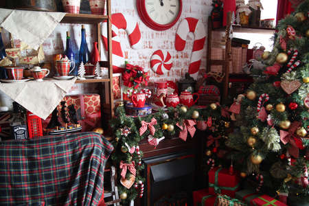 fireplace home: Christmas home decoration with tree, gifts and fireplace.