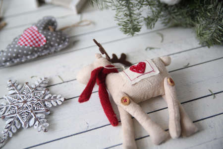 Christmas toy for holiday decoration on light wooden background Stock Photo