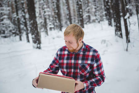 automatically: Men hands hold Christmas gift