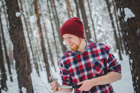 birch winter forest man with axe