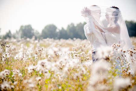 Married couple kissing in a church Reklamní fotografie