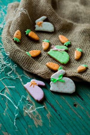 Easter gingerbread cookies in the shape of hares and carrots