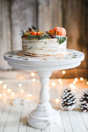 Christmas cake on a stand on the background