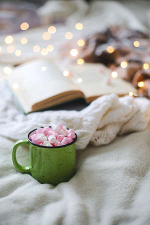 Christmas composition. garland book and marshmallow mug. Flat la