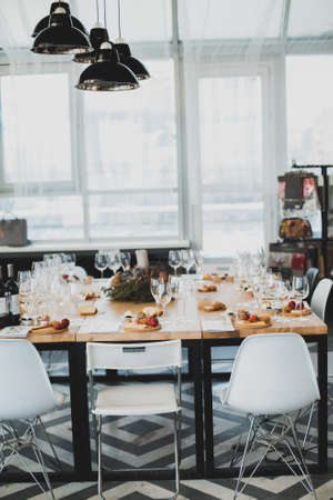 Table setting with wine and snacks, etiquette and event