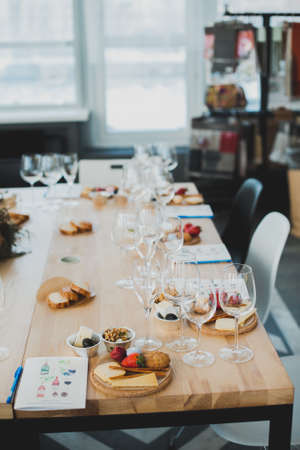 Table setting with wine and snacks, etiquette Imagens