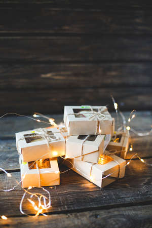 Christmas - a group of gifts on the background of garlands. close-up