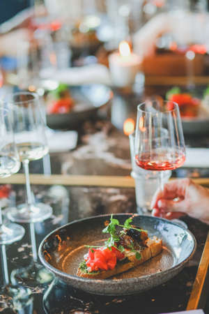 Close-up of food and wine glass on dining table in restaurant