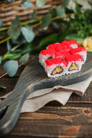 sushi with salmon and avocado. Sushi roll with salmon and tempura shrimp Imagens - 137048043