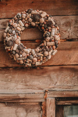 wreath of nuts and wine corks. christmas wreath made of natural materials Imagens - 158495603