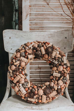 wreath of nuts and wine corks. christmas wreath made of natural materials Imagens - 158495266