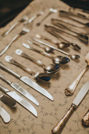 Silver cutlery on black background. food etiquette concept Imagens