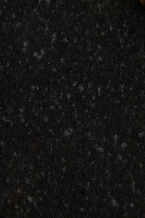Black stone background. Dark gray grunge banner. Black and white background. Mountain texture. Close-up. Volumetric. The rocky backdrop. Abstract black rock background. Detail. . High quality photov