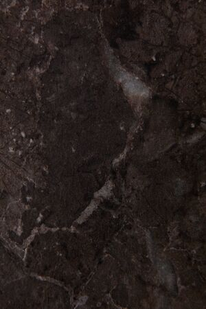 Brown stone background. Dark brown grunge banner. Mountain texture. Close-up. Volumetric. The rocky backdrop. Abstract brown rock background. Detail. . High quality photo