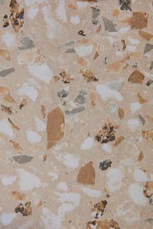 Abstract concrete background - in the form of a rough covered with folds wall, closeup. High quality photo