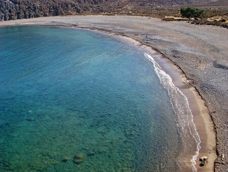 Beach in crete island karoumes background
