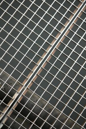 Jail metallic window with small quadrants diagonal strait lines macro background fine art high quality prints products fifty megapixels Stok Fotoğraf