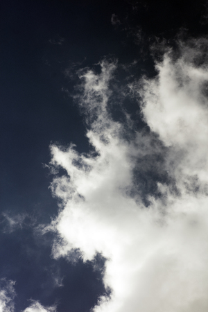 Black sky with white clouds dark mood space art in fifty megapixels