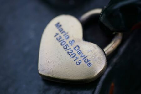 Heart lock with names in Amsterdam macro background high quality
