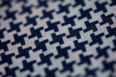 Textile design with black and white crosses macro background high quality
