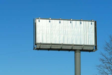 adboard: Blank billboard  against a blue sky.                            Stock Photo