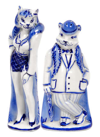 Saltshakers  look like  lady-cat and man-cat in  white-blue colors.                       photo