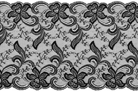 ornamentations: flowered  black lace on white background