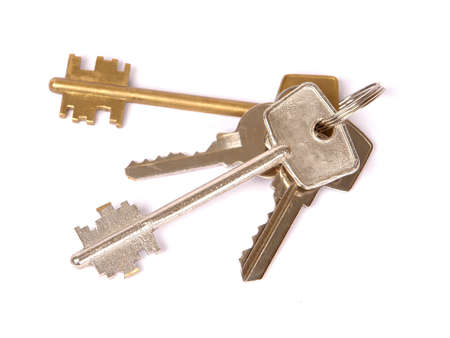 A bunch of keys isolated against a white background.                                photo