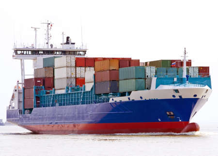 container ship sailing into port photo