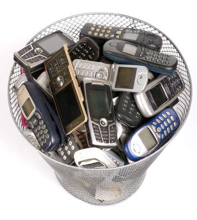 phone: rubbish bin full of old cellphones